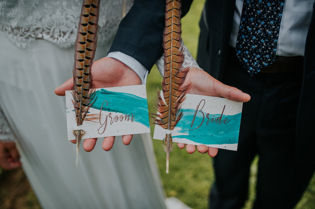 Bride and groom plantable, blue and orange, sustainable name cards with feathers - Pearl Weddings & Events