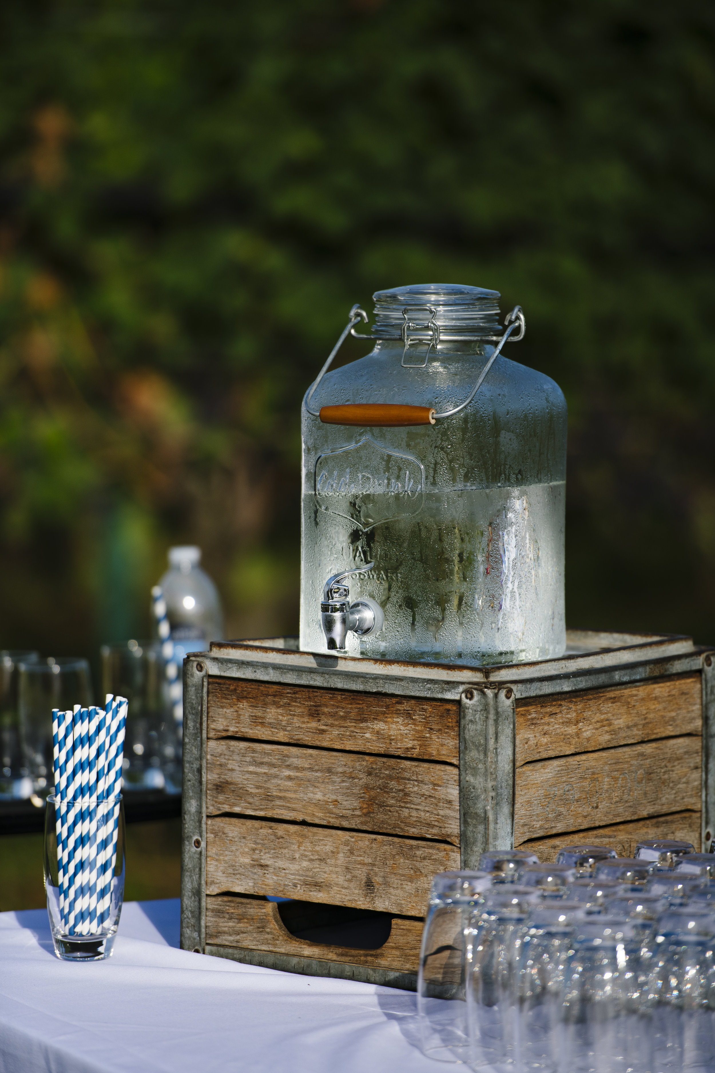Welcome Station with lemonade for the wedding ceremony at Jonathan Edwards Winery - Pearl Weddings & Events