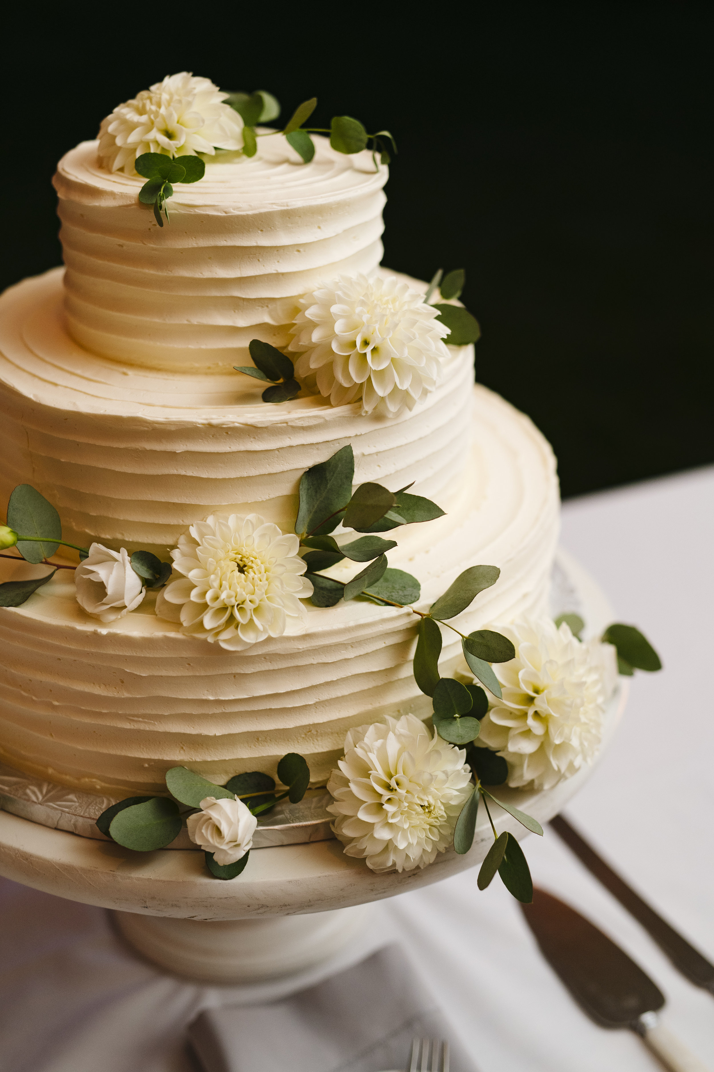 Tiered buttercream cake by A Thyme To Cook with Brambles and Bittersweet flowers at Jonathan Edwards Winery in Connecticut - Pearl Weddings & Events
