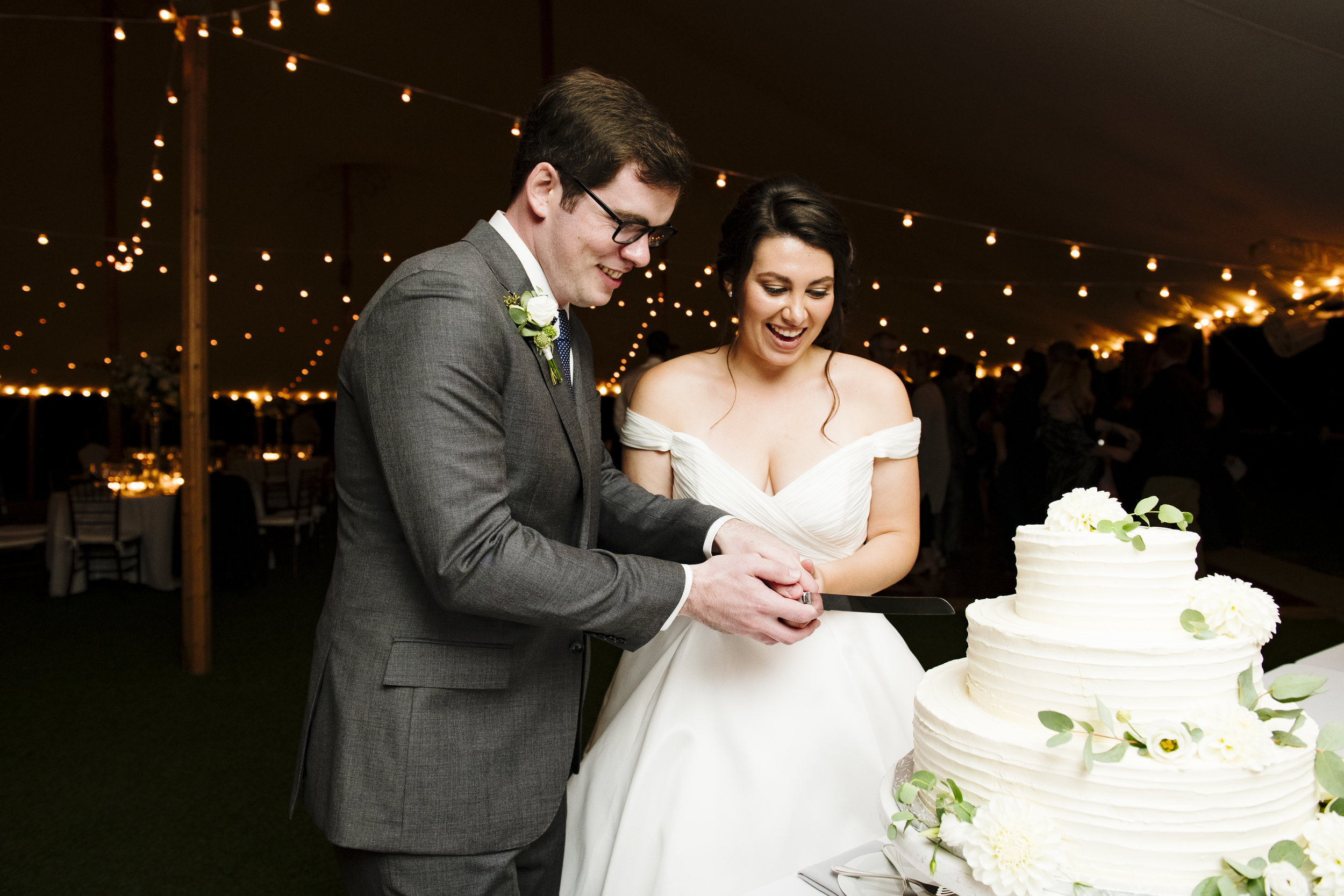Cake cutting with the bride and groom at Jonathan Edwards Winery - Pearl Weddings & Events