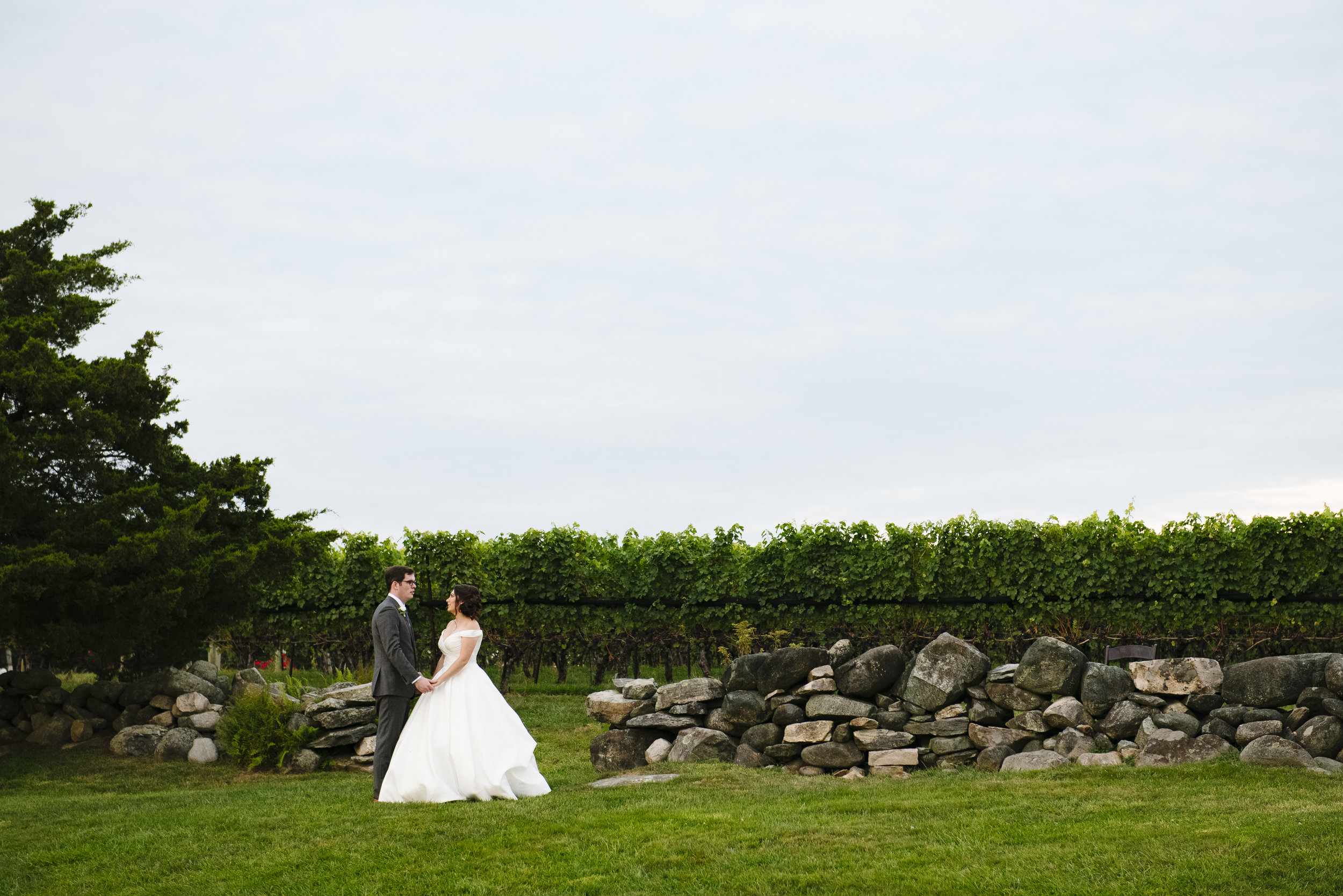 Bride and groom getting married at Jonathan Edwards Winery in Connecticut - Pearl Weddings & Events
