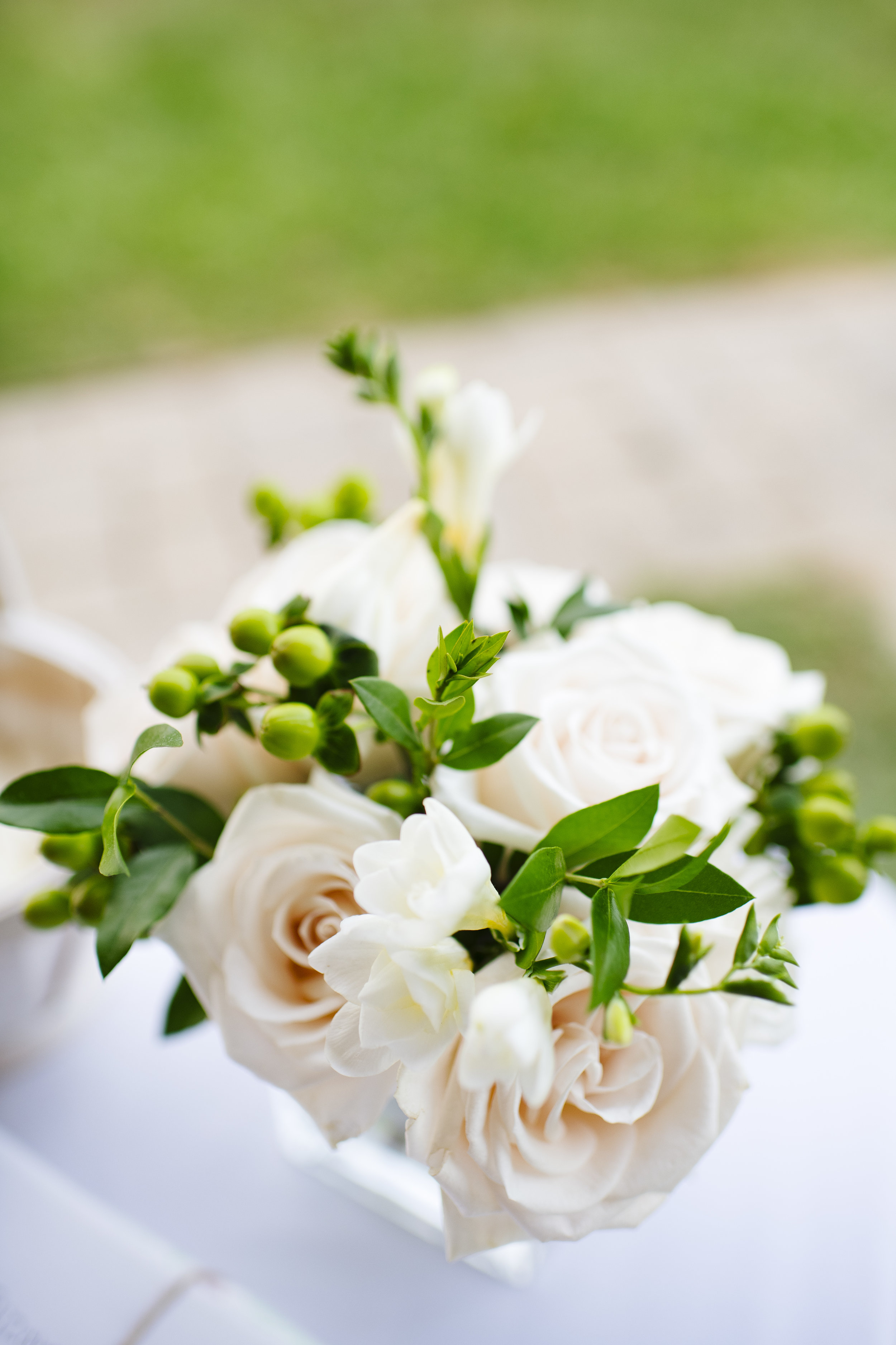 white roses, greenery and grape vine wedding florals. Simple, classy and elegant at a vineyard. - Pearl Weddings & Events