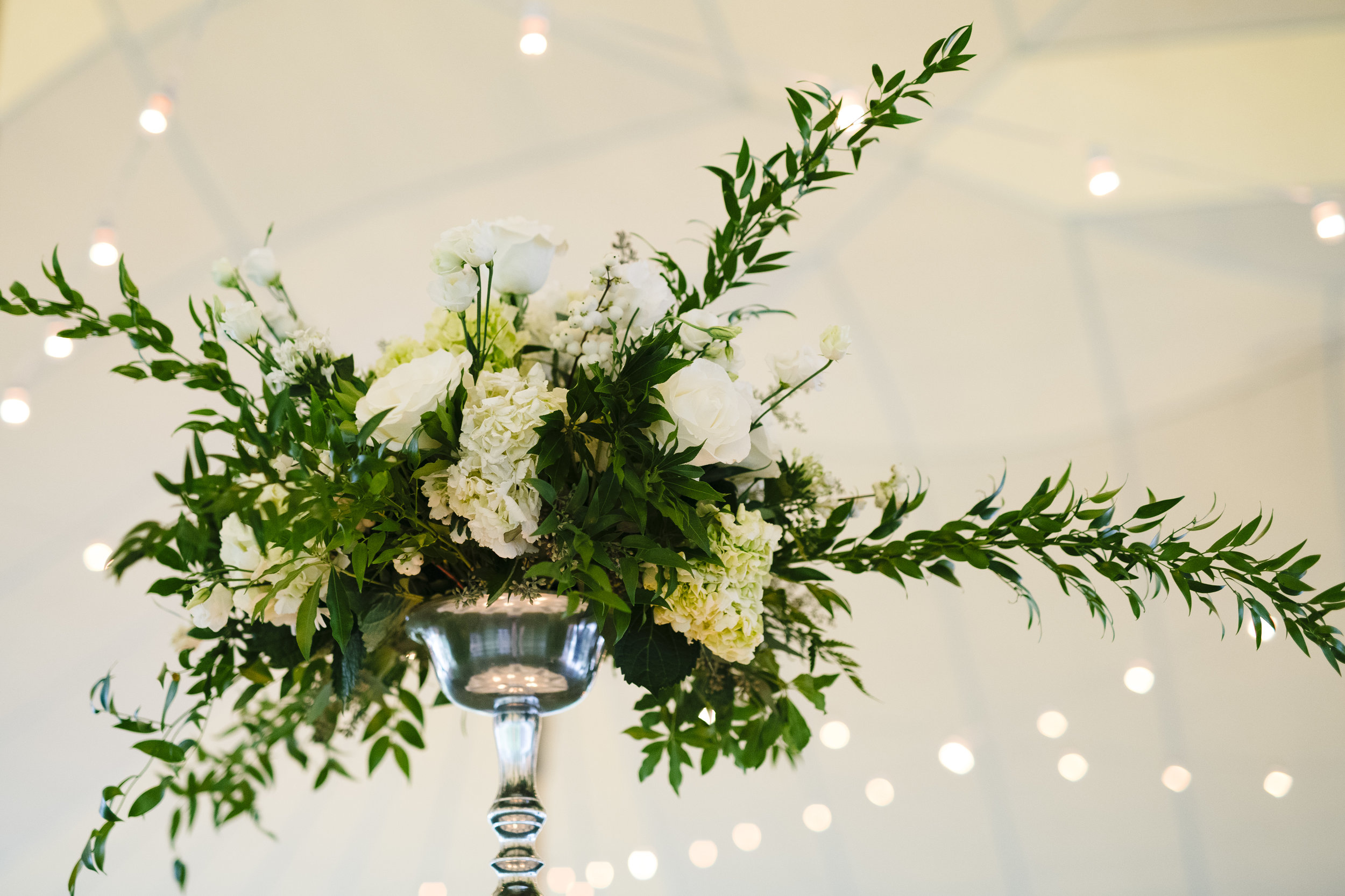 Tall wedding centerpieces un a sperry tent at Jonathan Edwards Winery. Classy, elegant and timeless floral centerpieces. - Pearl Weddings & Events