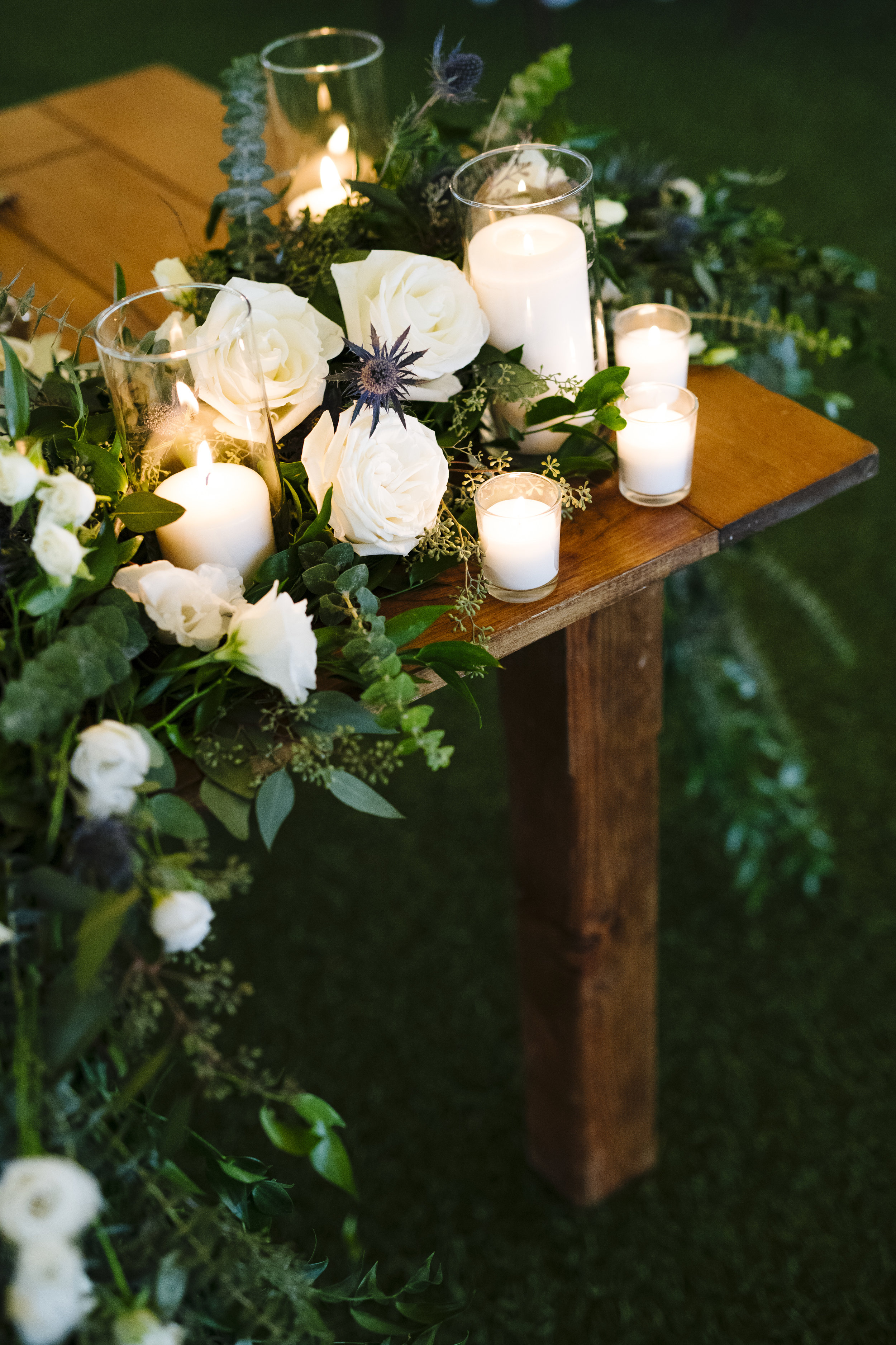 sweetheart table with lush greens and white roses at Jonathan Edwards Winery - Pearl Weddings & Events