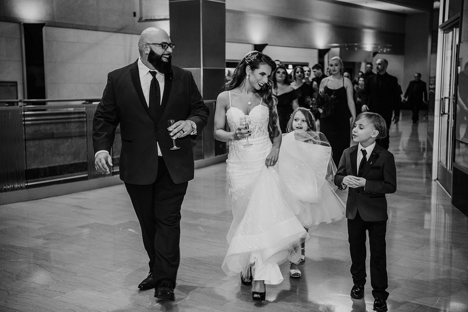 Family of four on the wedding day looking so happy together! - Pearl Weddings & Events