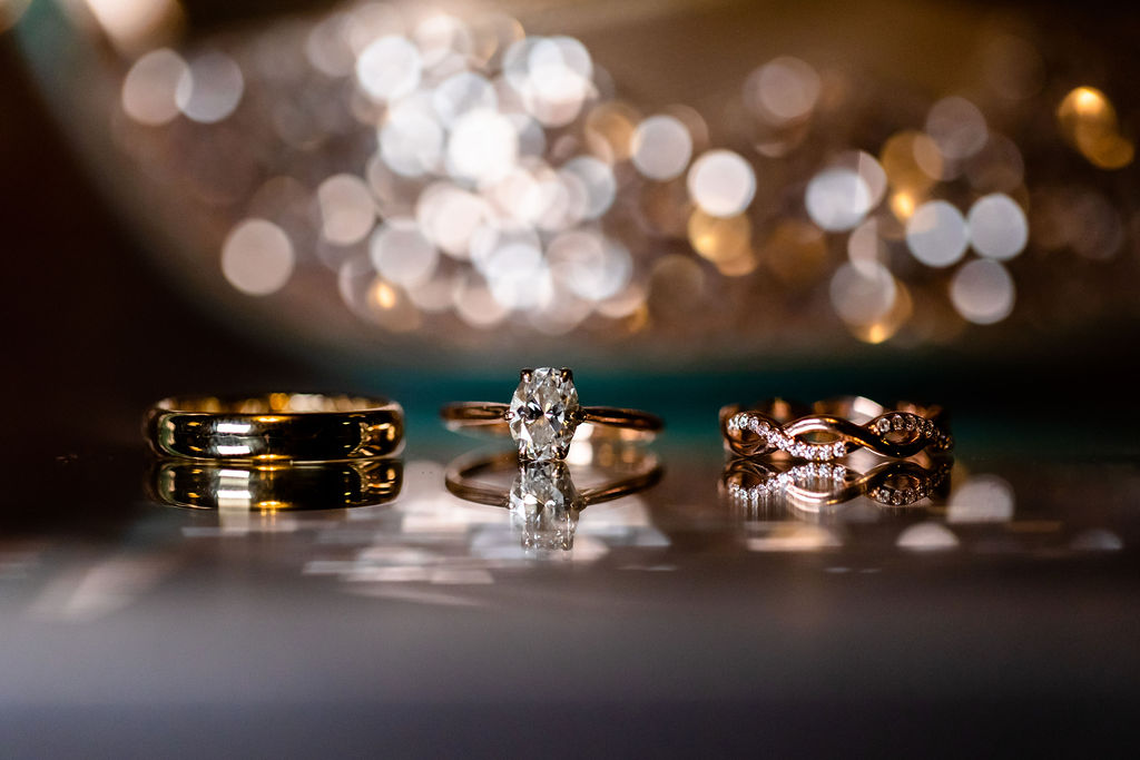 Rose gold and gold wedding and engagement rings for the bride and a gold band for the groom. - Pearl Weddings & Events