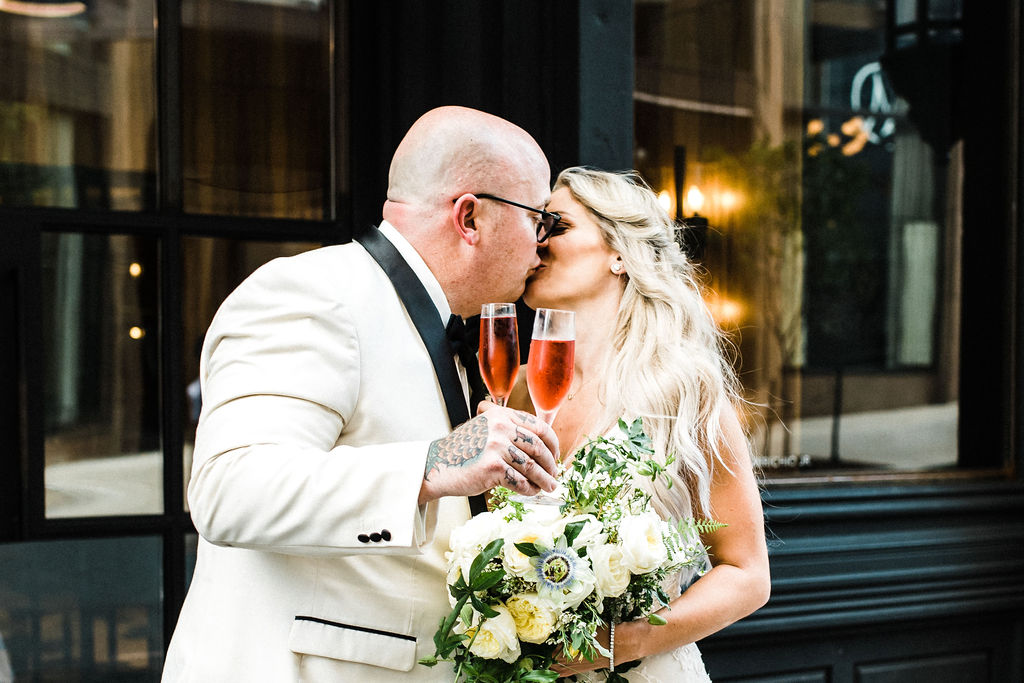 Melanie and Tyler Anderson wedding at the Goodwin Hotel in Hartford Connecticut, drinking rosè and enjoying life as husband and wife! - Pearl Weddings & Events