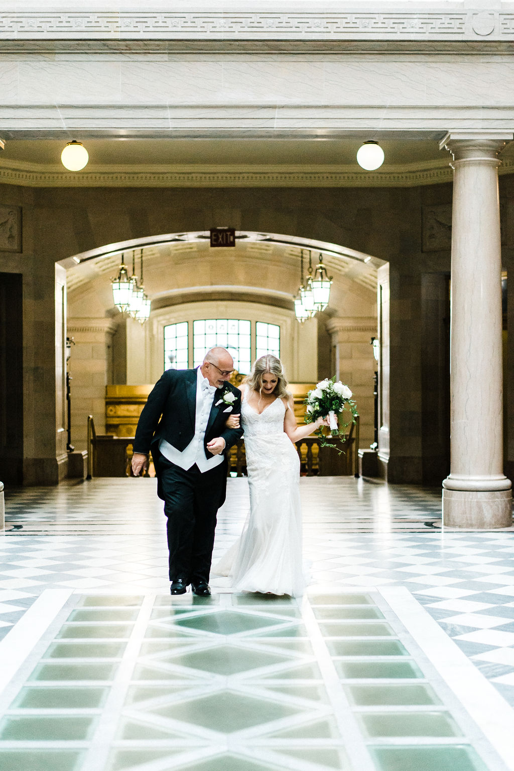 Bride dancing down the aisle at her great gatsby themed wedding - Pearl Weddings & Events