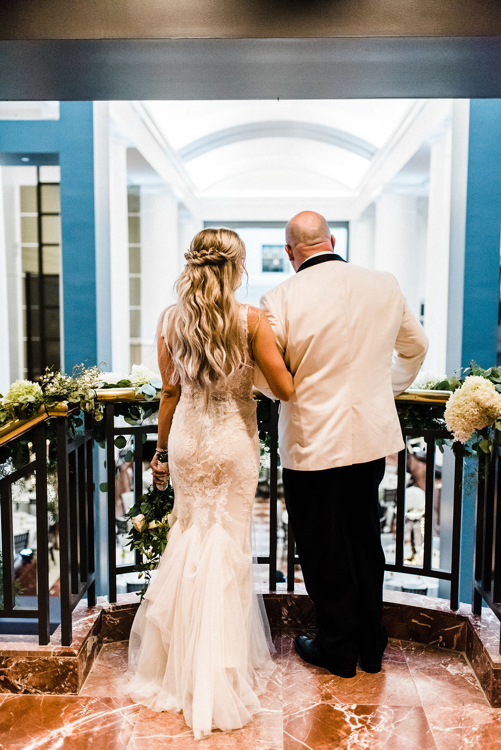 The first moment the bride and groom see into the ballroom of their wedding - Pearl Weddings & Events