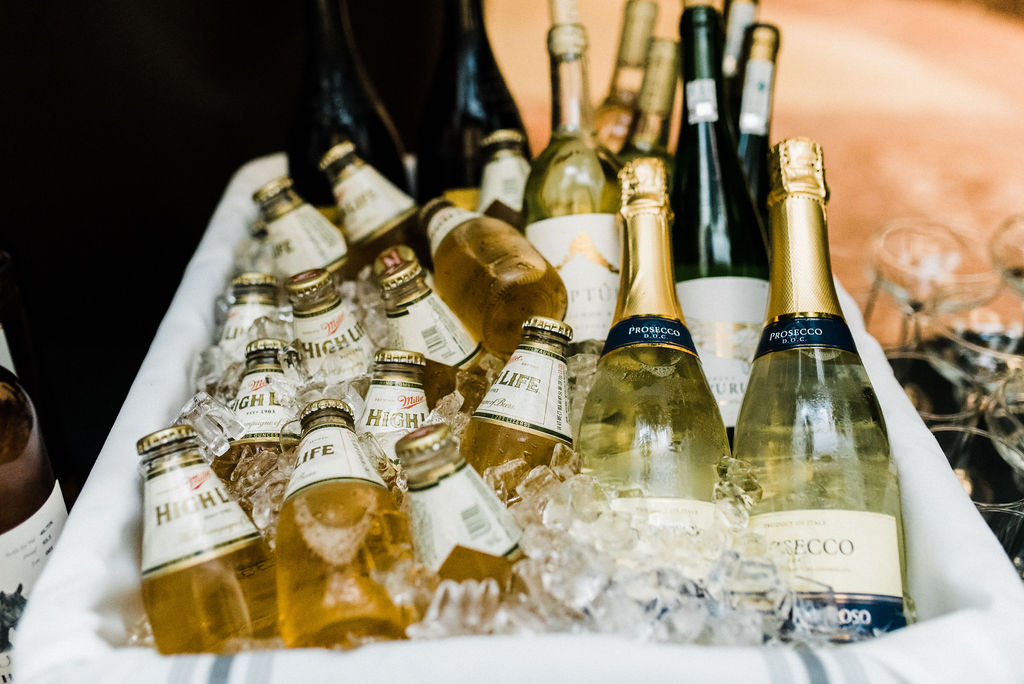 Miller high life and Prosecco served at a Great Gatsby Themed wedding by Porrona & Pina at the Goodwin Hotel - Pearl Weddings & Events