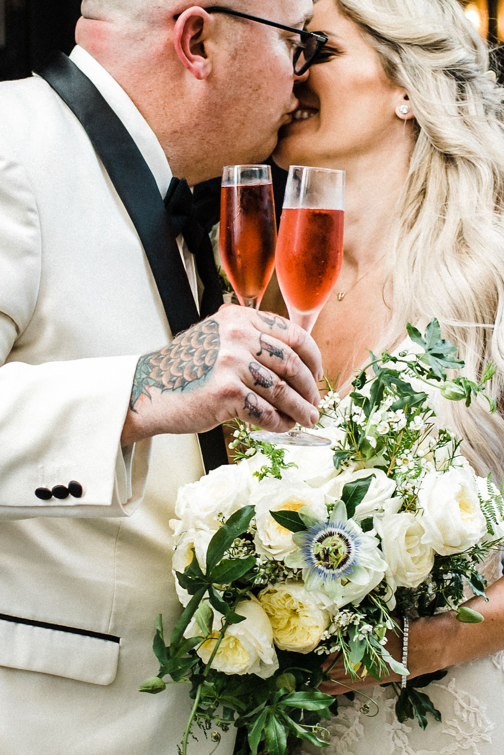 Bride and groom cheersing with rose on their wedding day in Hartford, CT - Pearl Weddings & Events
