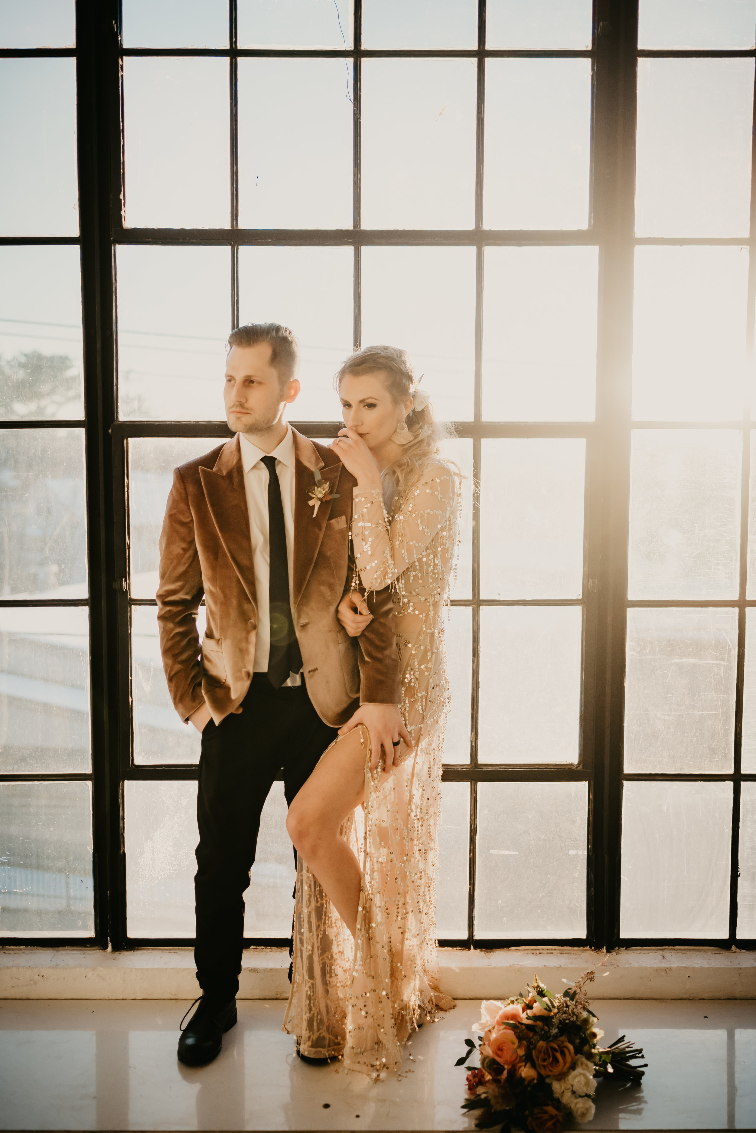 Bride in a sequins gown and groom in a velvet jacket for their Mid-Century Modern Boho wedding - Pearl Weddings & Events