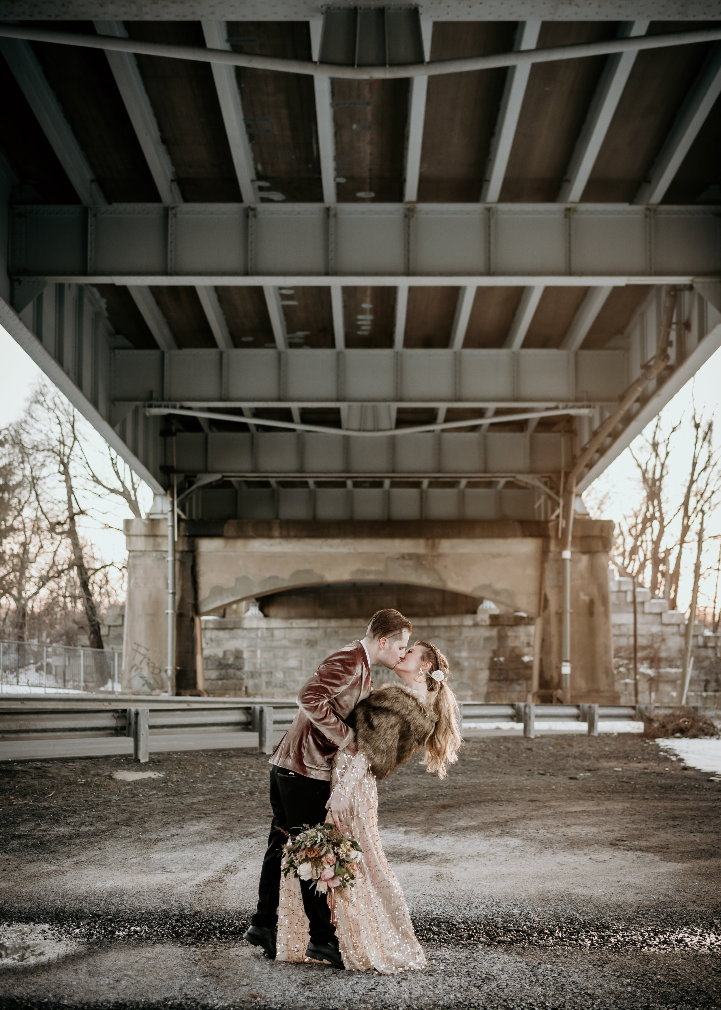 Under the bridge in Middletown, CT in the middle of winter capturing the best couple session photos - Pearl Weddings & Events
