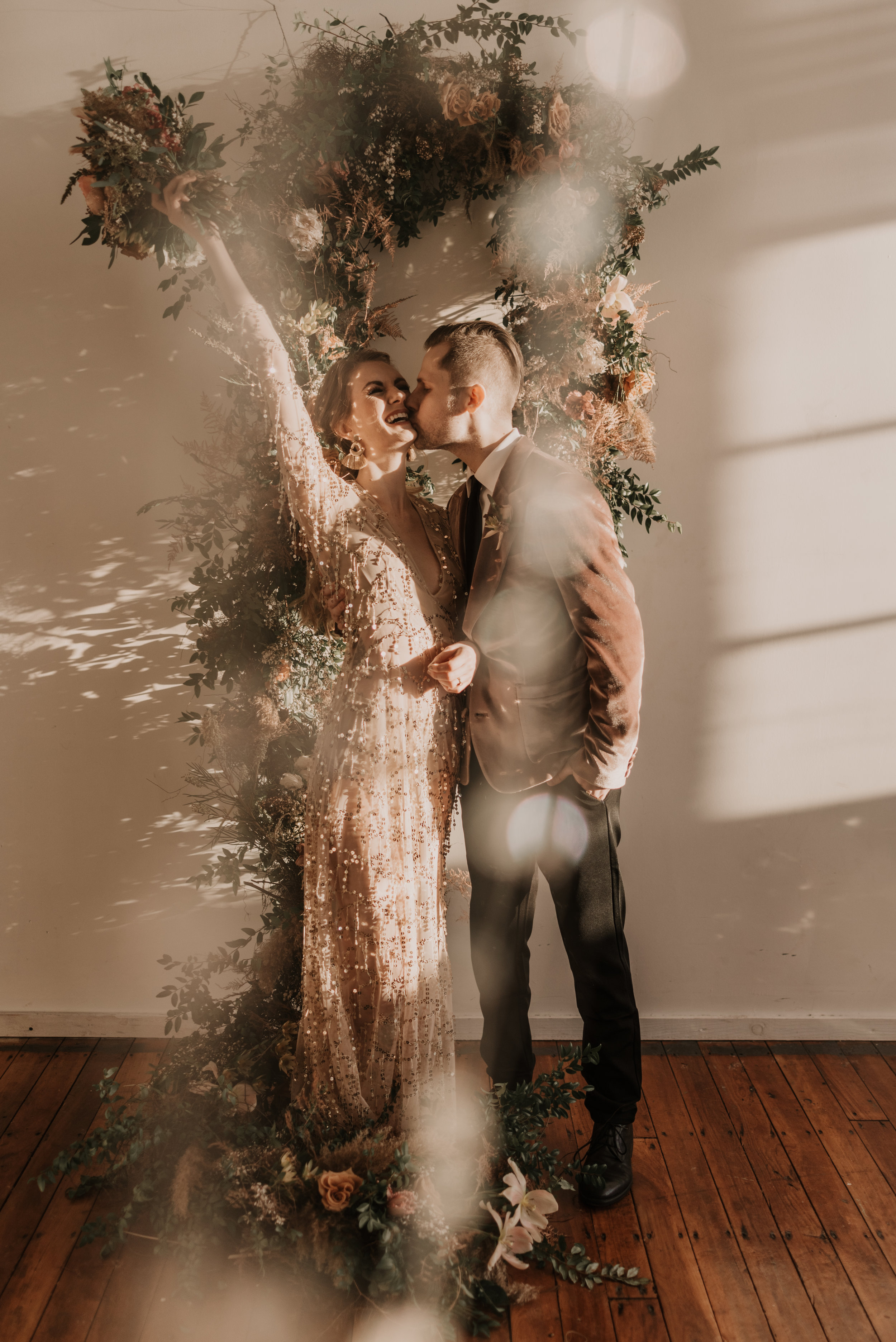 Bride and Grooms first kiss at their Mid-Century Modern Boho wedding - Pearl Weddings & Events