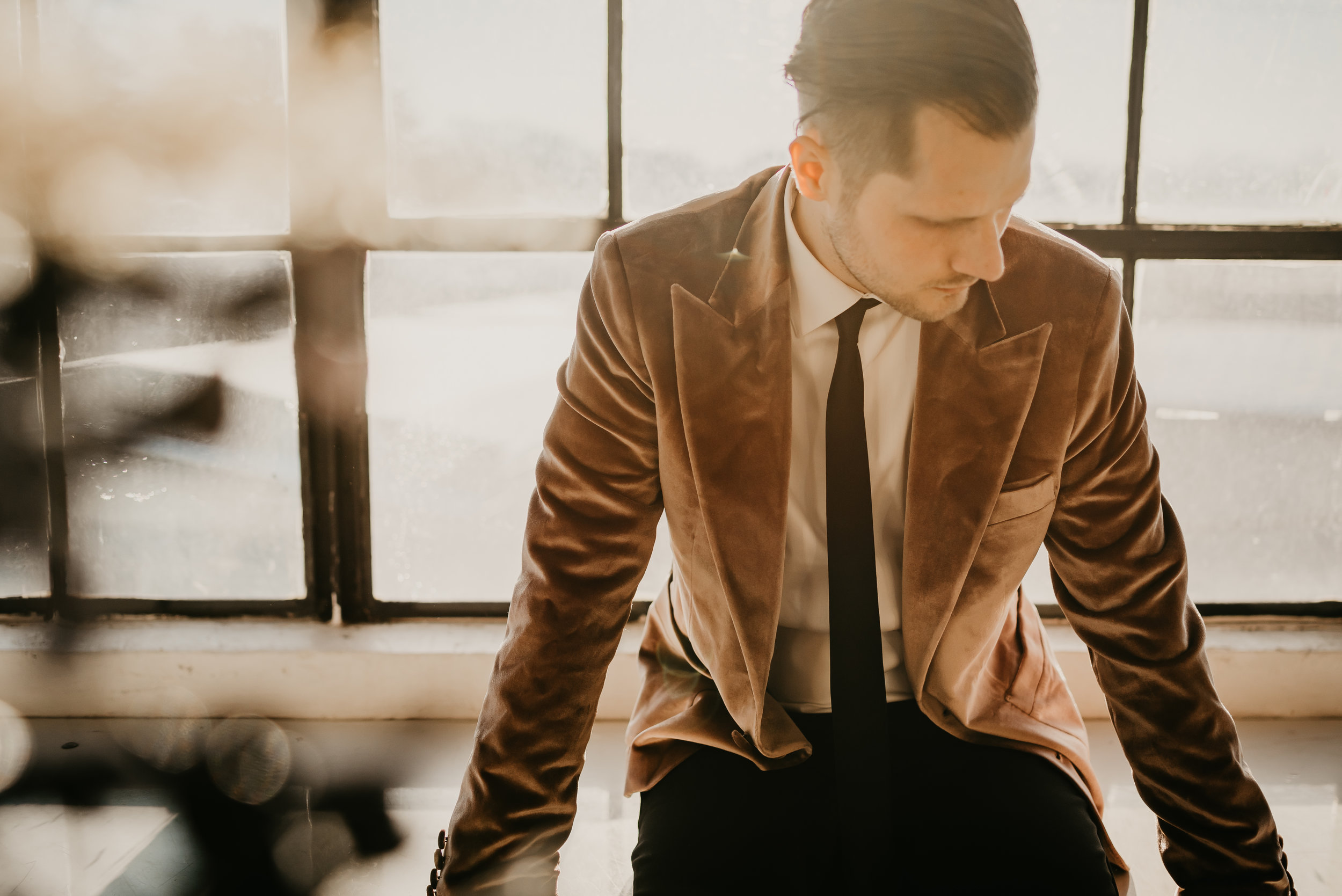 Grooms Attire | Tan Velvet Jacket with Black tie and pants - Pearl Weddings & Events