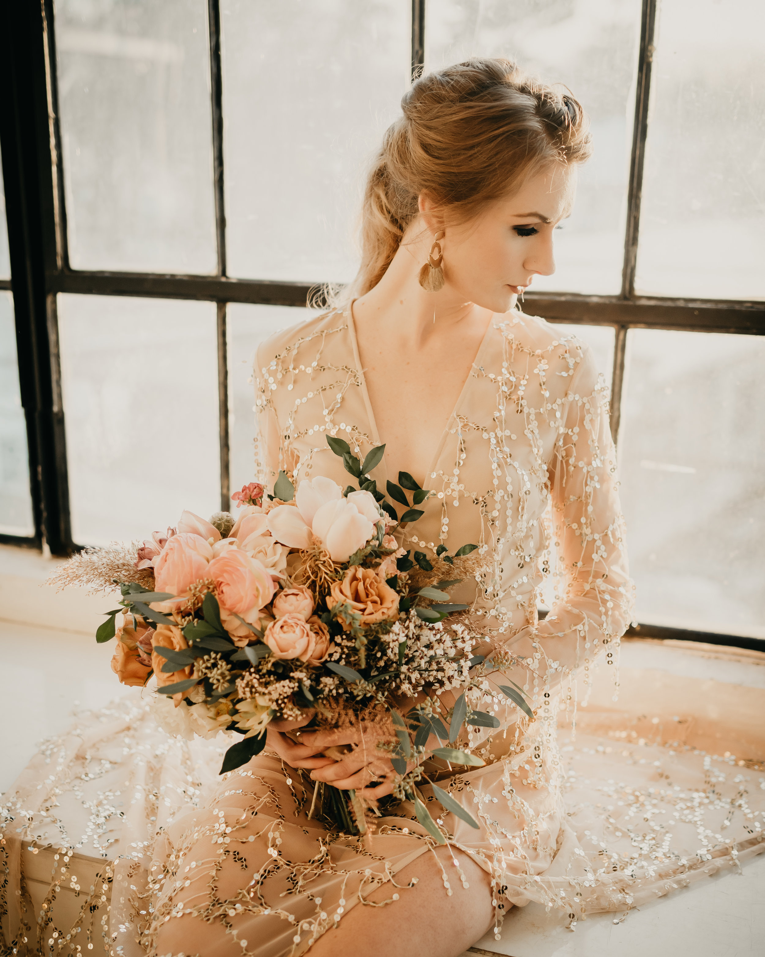 Neutral colored wedding with a sequins dress and full bridal bouquet - Pearl Weddings & Events