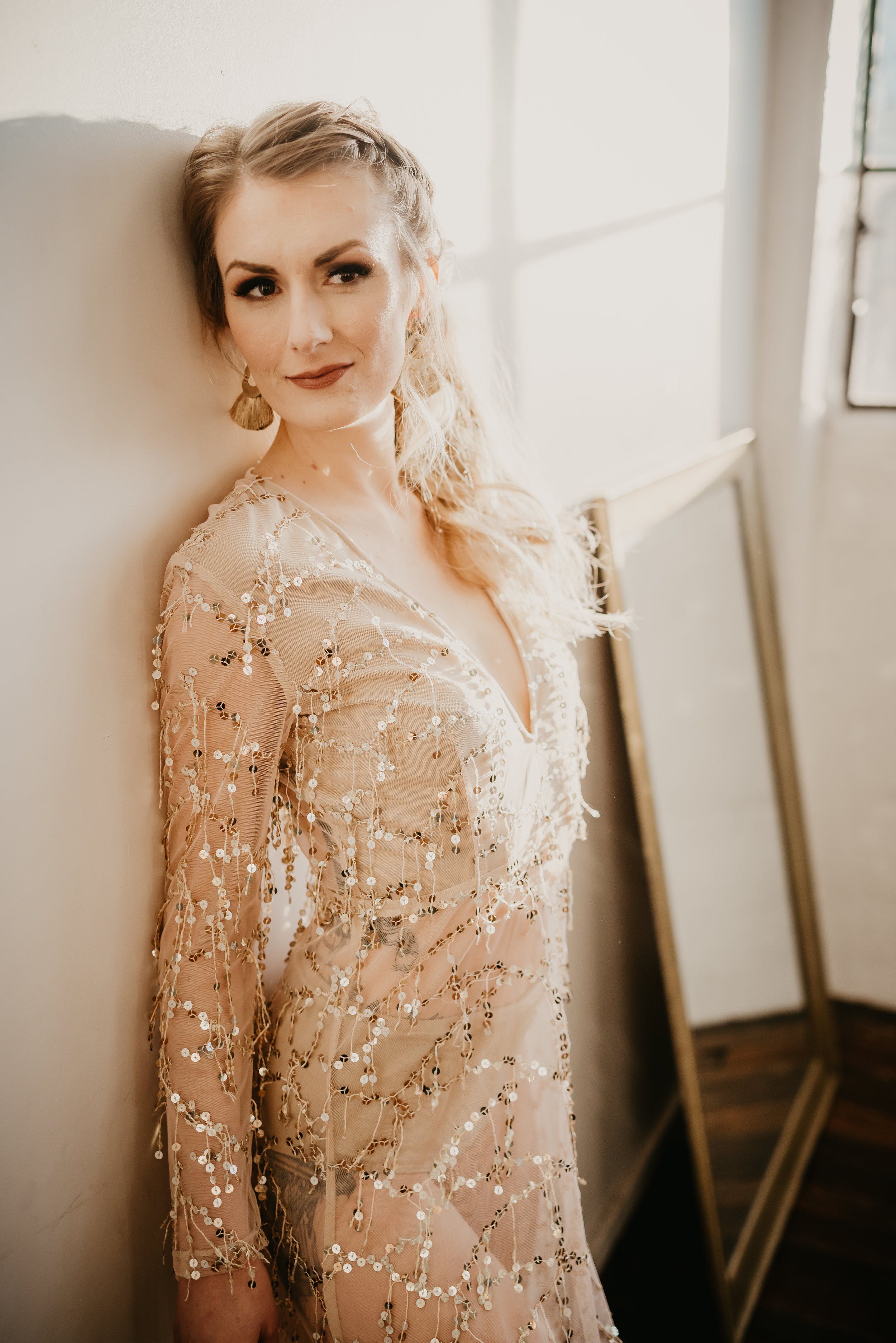 Bride in her sequins dress with a pony tail up do for her mid-century modern boho wedding - Pearl Weddings & Events