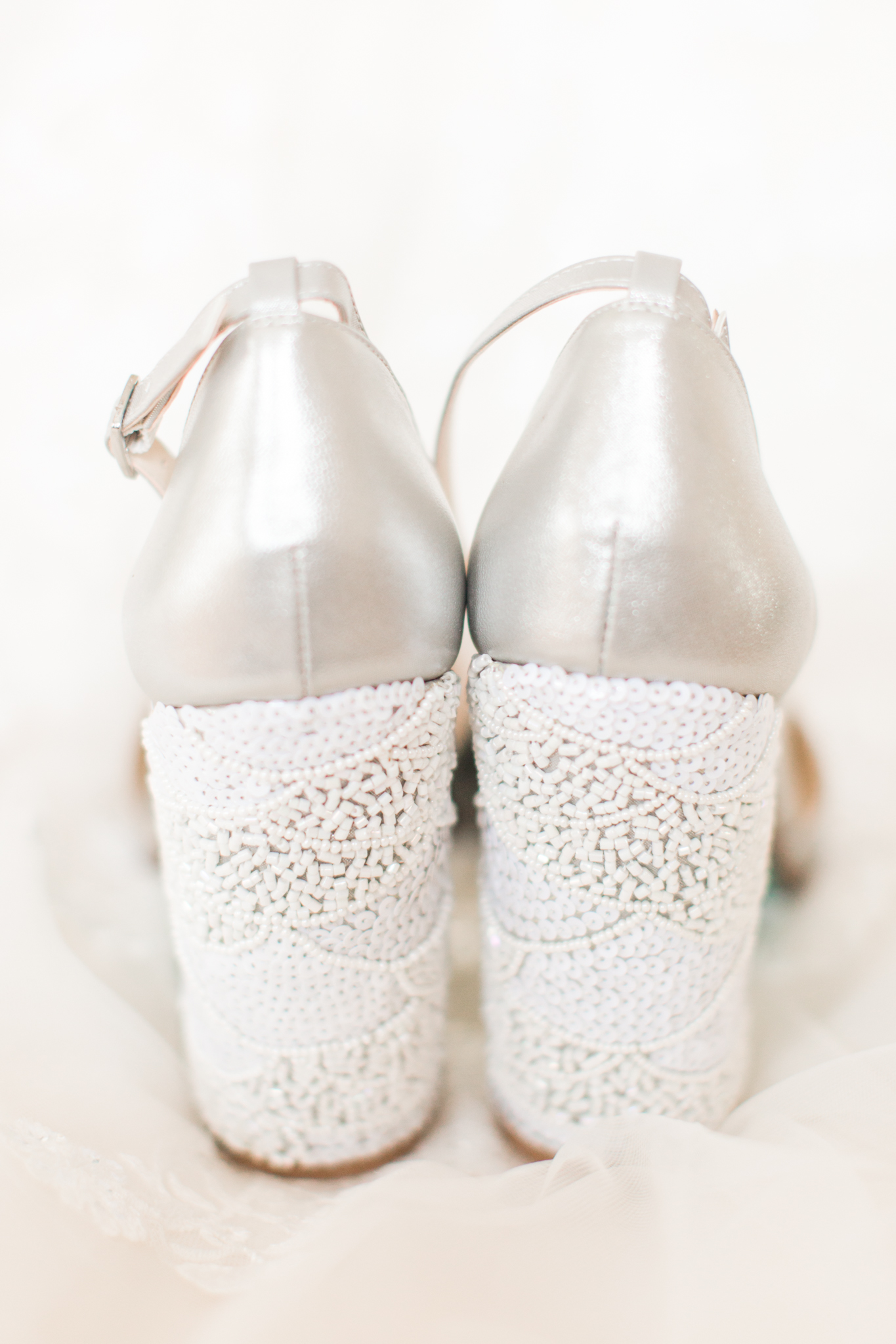 Silver close toes brides shoes with chunky heel peal details in white. - Pearl Weddings & Events