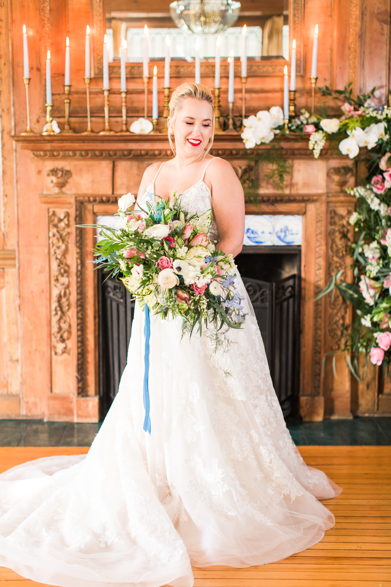 Elegant and whimsical bride with a red lip stick, pink, green and white flowers for her bouquet and an A-Line dress - Pearl Weddings & Events