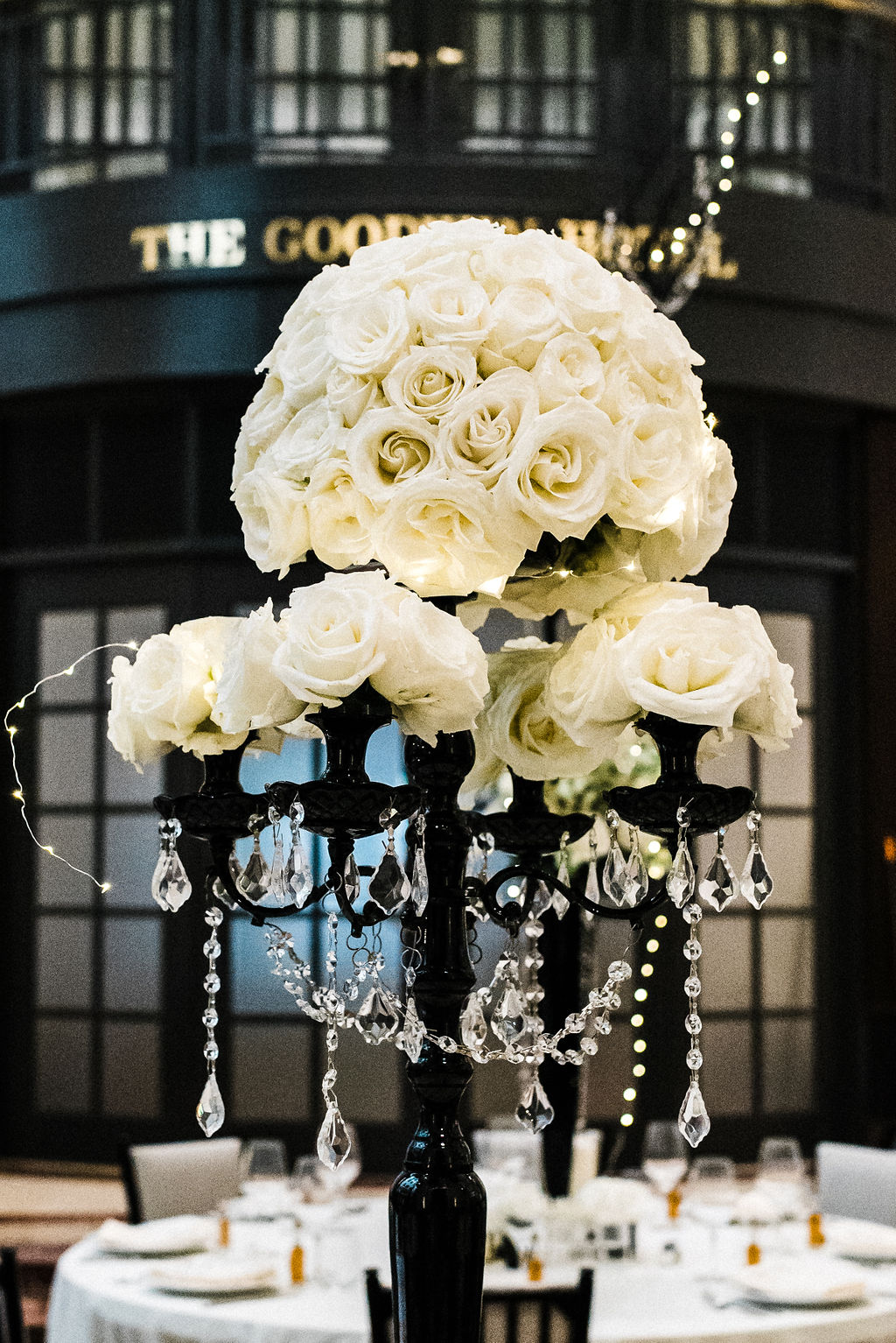 Tall black and white rose floral centerpieces for Melanie & Tyler Anderson's wedding - Pearl Weddings & Events