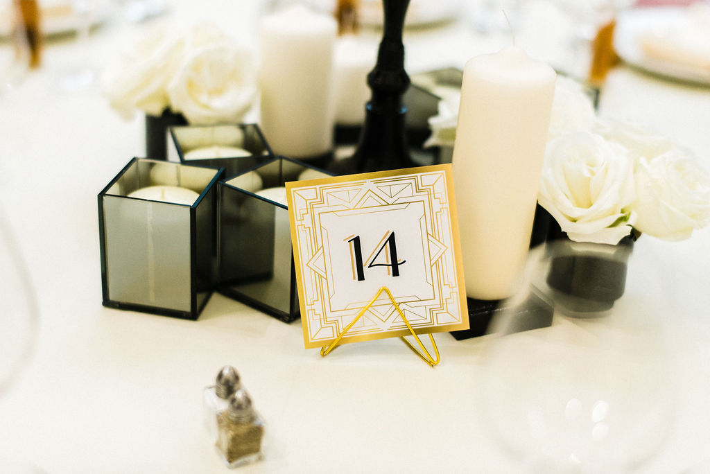 Black, white and gold details for the tables centerpiece at a Great Gatsby themed wedding - Pearl Weddings & Events