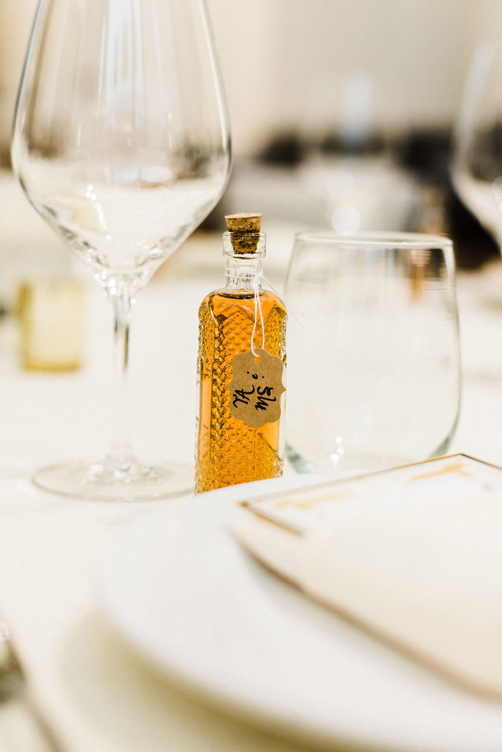 Small bottles of liquor as favors for the guest at Melanie & Tyler's Great Gatsby themed wedding at The Goodwin Hotel - Pearl Weddings & Events