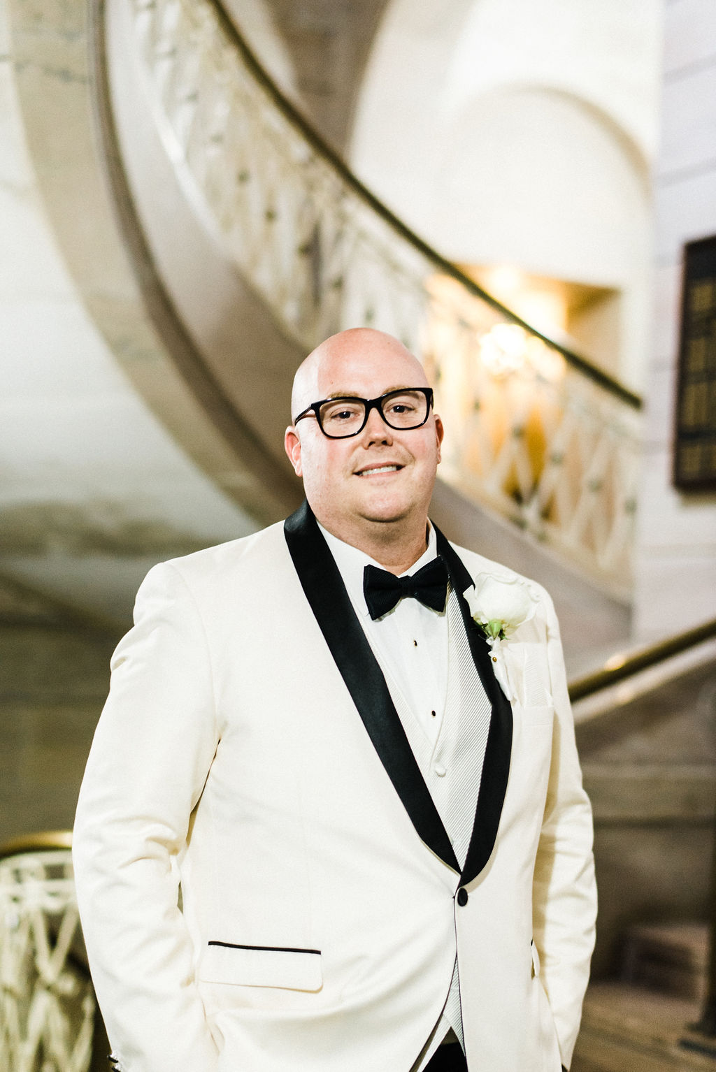 Tyler Anderson looking fabulous on his wedding day wearing a Vera Wang all white suit and bow tie - Pearl Weddings & Events
