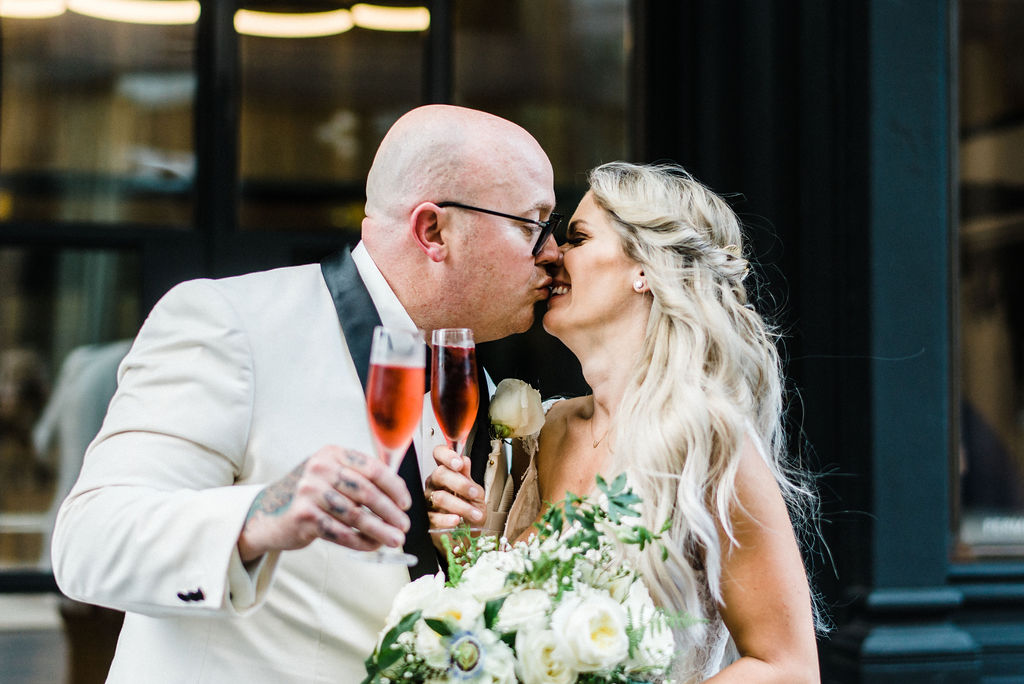 Melanie and Tyler on their wedding day at The Goodwin Hotel! - Pearl Weddings & Events