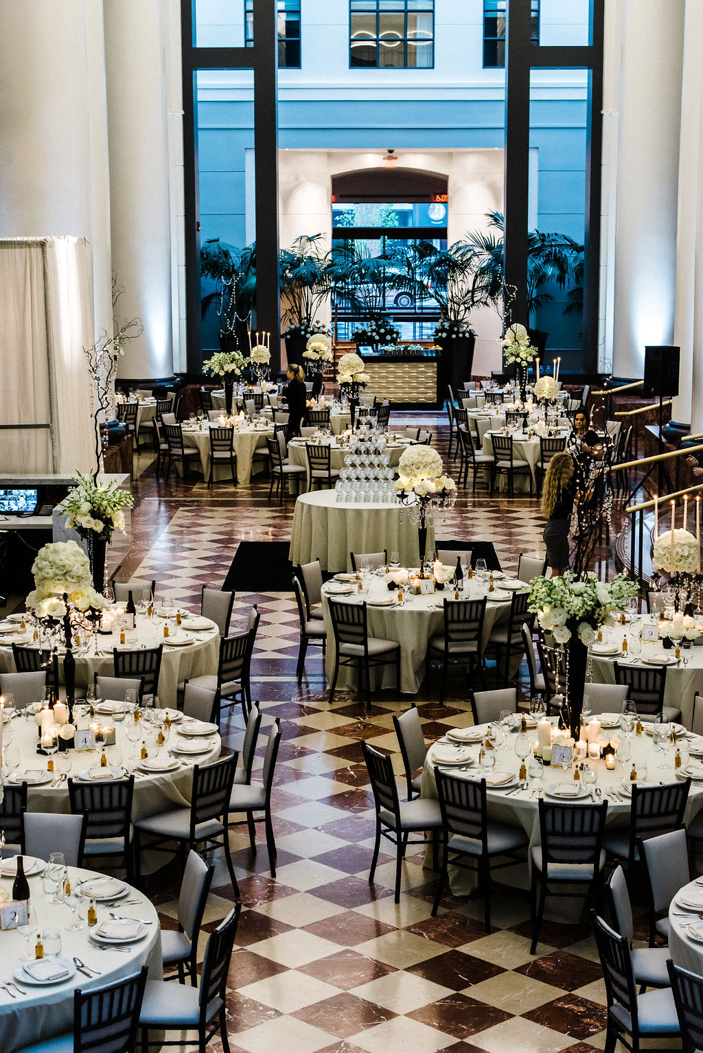 A beautiful floor plan at The Goodwin Hotel with a champagne tower in the center of the dance floor for Melanie & Tyler Anderson's wedding - Pearl Weddings & Events