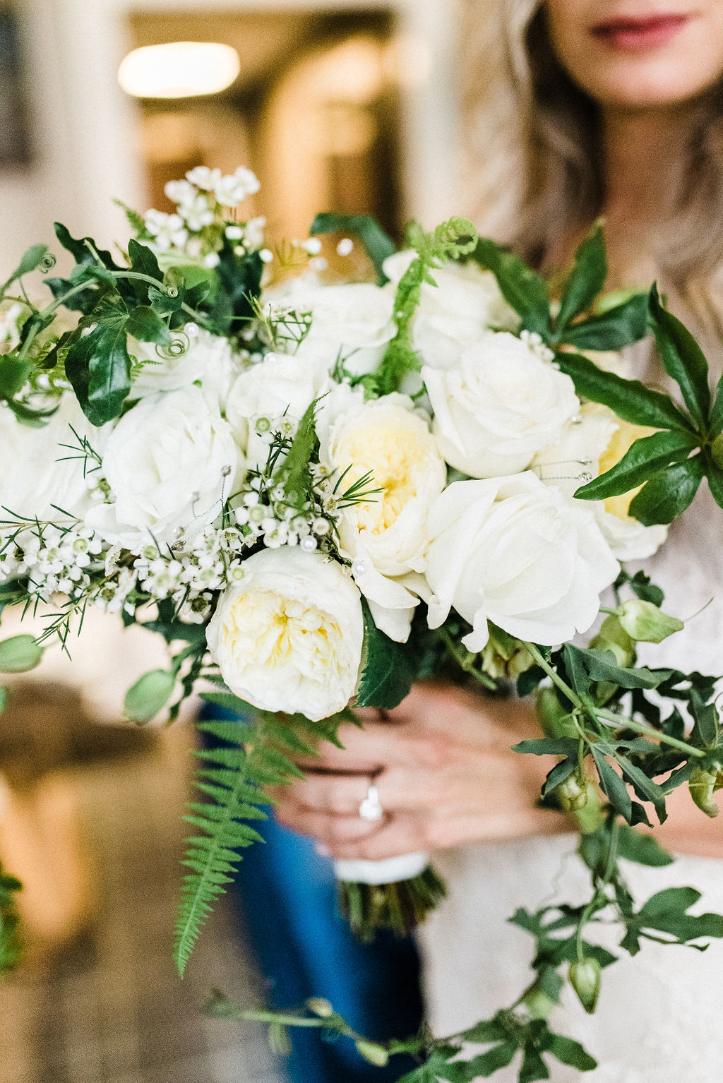 Brides bouquet with white roses, greenery and blue and white passion flowers - Pearl Weddings & Events