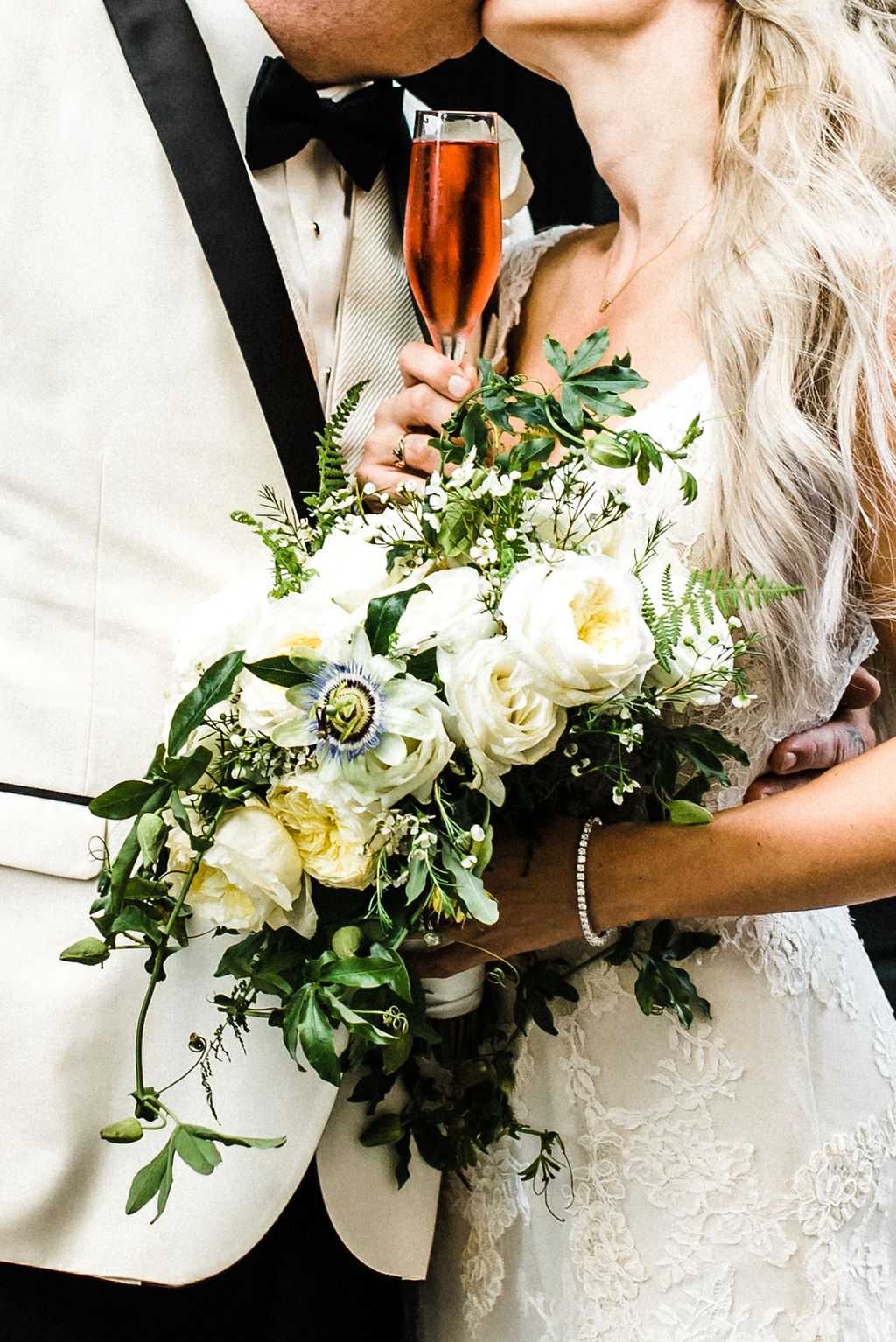 Melanie's passion flower, white rose and greenery bouquet designed by Ruth L. - Pearl Weddings & Events