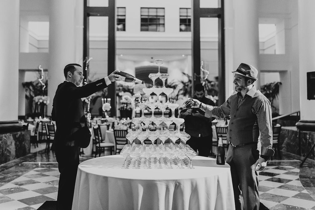 Porron & Pina displayed a Champagne tower at Chef Tyler Anderson's wedding - Pearl Weddings & Events