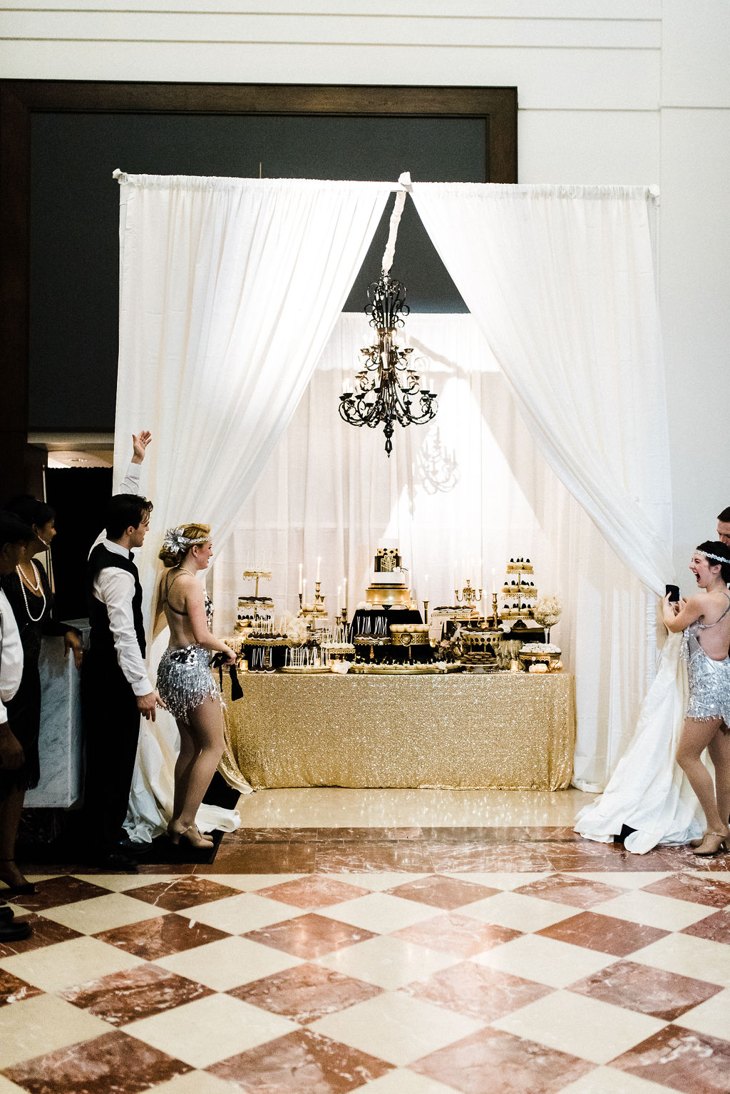 Cake and dessert display at Melanie and Tyler Anderson's great gatsby themed wedding Glen Crytzer's 1940's band for a Great Gatsby themed wedding - Pearl Weddings & Events