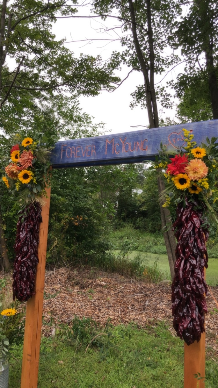 New Mexico Ristras For a Wedding Ceremony Arch with Sunflowers - Pearl Weddings & Events