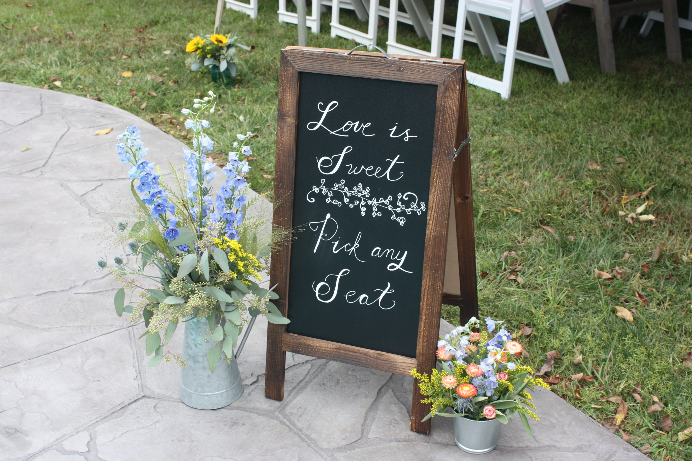 Love is sweet pick any seat sign for a outdoor tented wedding reception - Pearl Weddings & Events