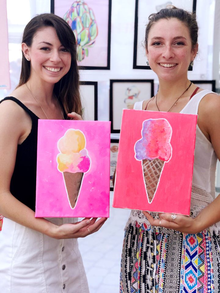 two girls with pink pink ice cream paintings.JPG