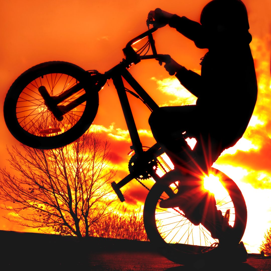 boy-on-bmx-silhouette-picture-id140269786.jpg