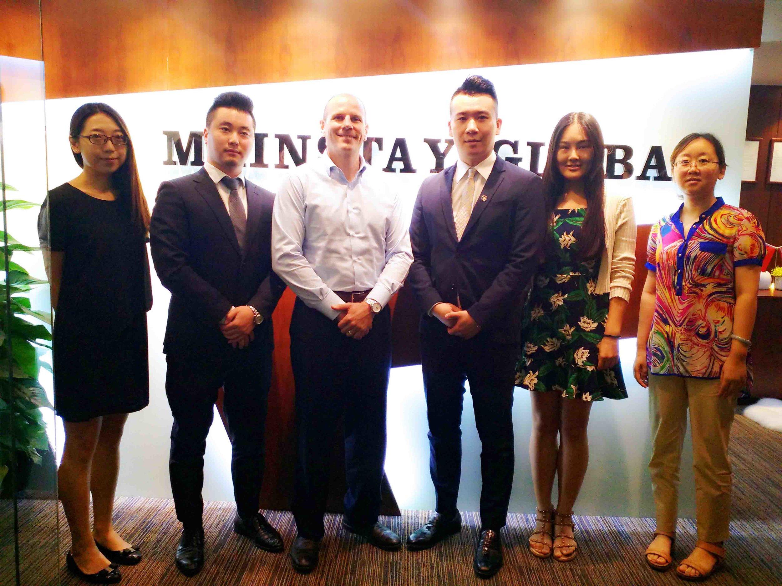 MG BJ Team in front of officea.jpg