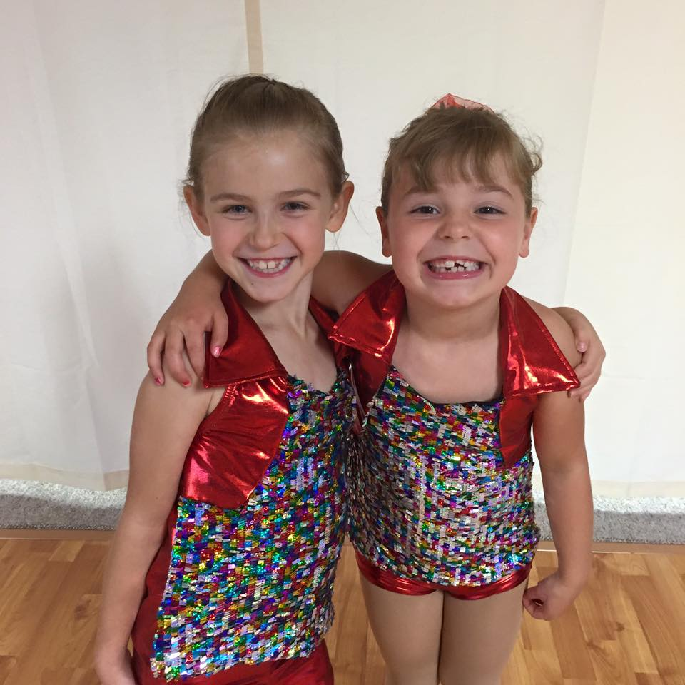 "Sparkle Stars! - Our Sparkle Level Classes for 5-6 year olds!$49/mo for 45 min class once per week (10% discount for the 2nd and 3rd classes for the same student)Please click the ""Register"" button above for days and times!**Performance Opportunities (optional)**Roanoke Fall Festival Parade (T shirt required for $20)Festival of Trees (Costume required for $70)Mad Ants (T shirt required $20, same T shirt as parade t shirt)Komets Hockey Performance (T shirt required $20, same T shirt as parade t shirt)Spring Showcase(Costume required for $70 per dance style/class)Watch your child's eyes light up with delight as they hear their favorite song being played in our large dance room. Soon their toes start tapping and their heads start bobbing to the beat. They watch with intent as their instructor teaches them engaging choreography to the music they love.A fun and engaging class for 5-6 year olds. Our Sparkle level teaches beginning and continuing ballet, tap, and hip hop skills and combinations. Correct body placement and terminology will be introduced. We also will work on basic rhythm and movement exercises. This is a fun, lightly structured, recreational class your child is sure to enjoy!Attire is any color or style of leotard, bike shorts, or tights. Skirts or tutus may be worn, but if they are a distraction to your student, they will be asked to remove them. Pink ballet shoes purchased from DancinKids, tan buckle tap shoes (may also be purchased from DancinKids). Hip Hop and jazz classes require tan jazz shoes."