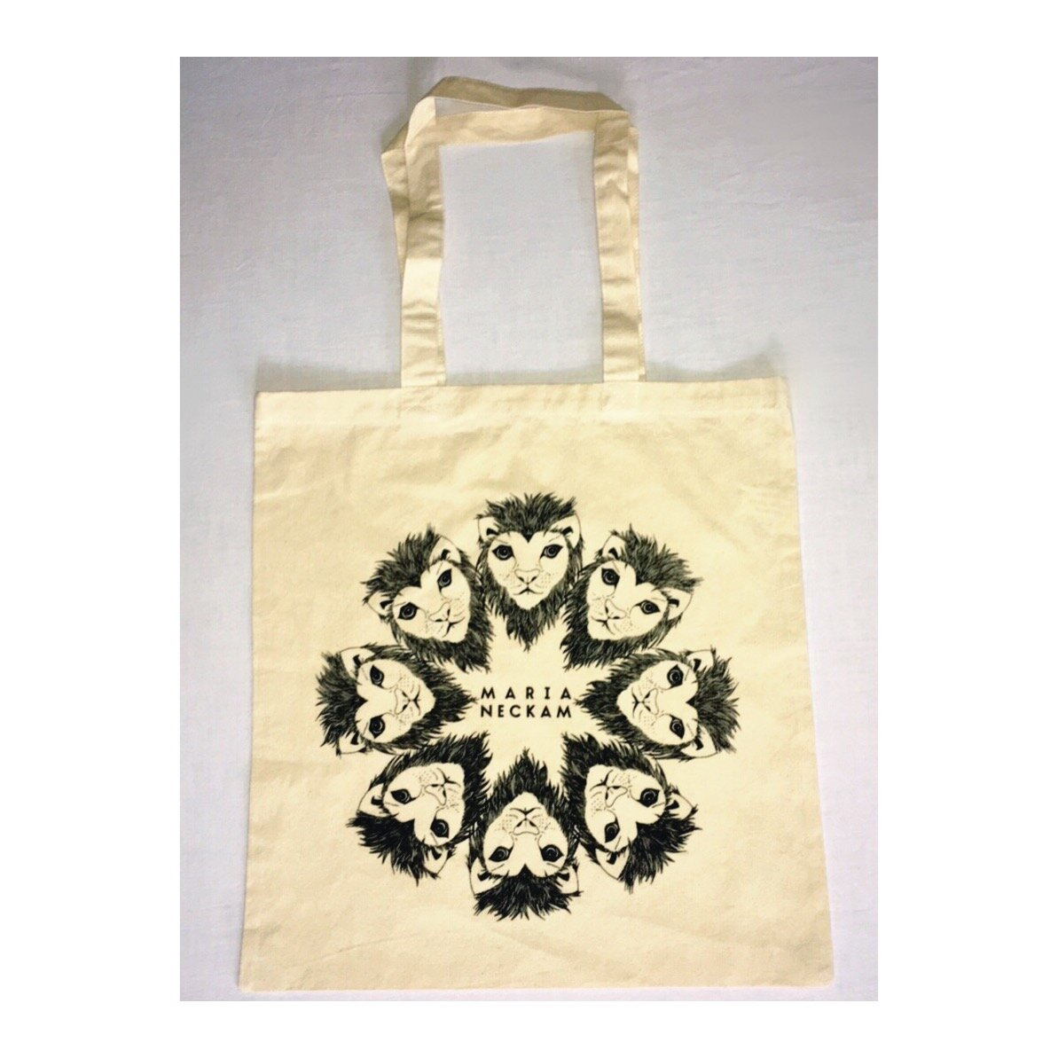 Maria NeckamNatural Tote Bag - $20Available in black & natural (off-white) color.Screen-printed in Brooklyn.Multifunctional! Rock it as your all-around bag, grocery shopping bag, or drum-stick-carrier ...