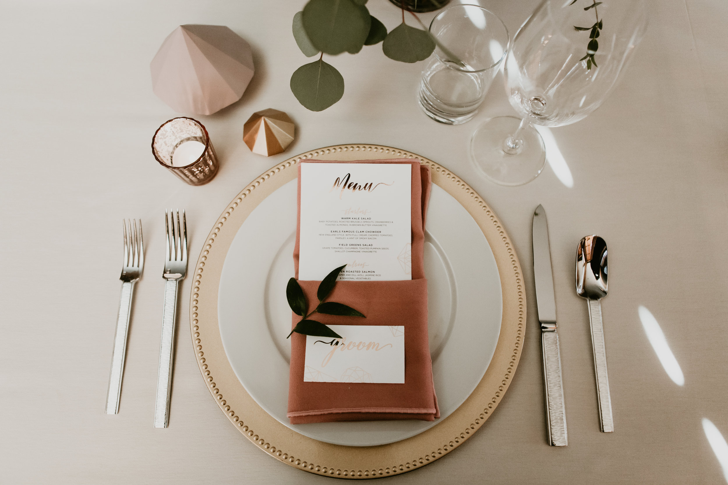copper and gold place setting