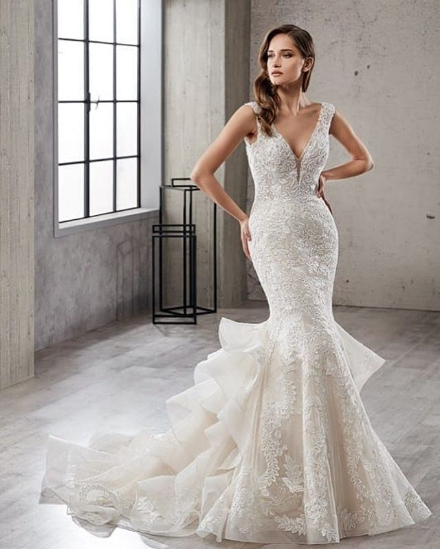 Show off your curves with this stunning lace dress that gives you the perfect silhouette! ❤️ Elizabella's Bridal has your Eddy K dreams.  #weddingdress #bridal #dreamdress #bridalparty #cheers #marriage #bridalgowns #weddingperfect #vows #bouquet #eddyk #eddykbridal