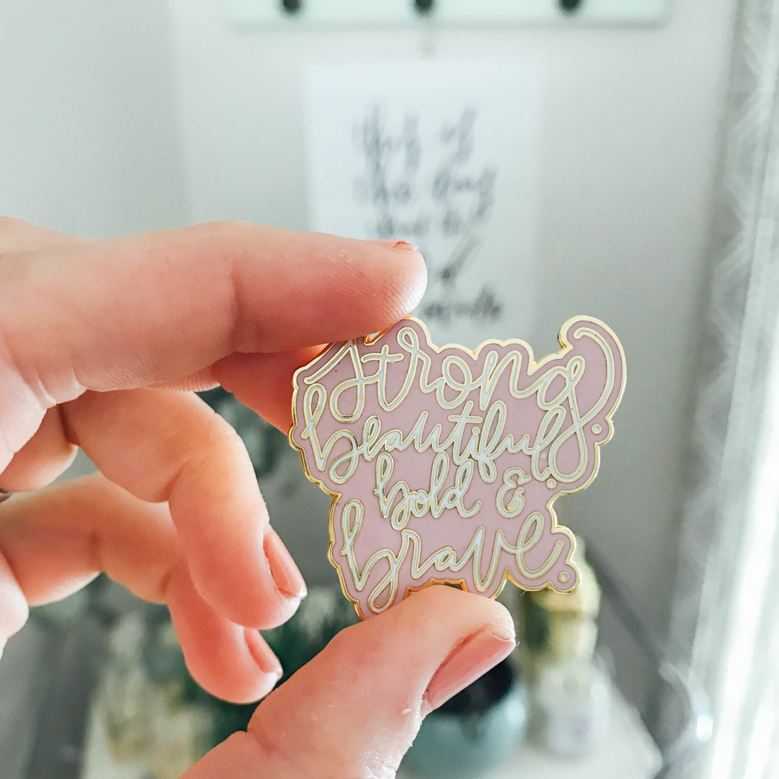 """This """"strong, beautiful, bold, and brave"""" enamel pin is perfect for a jacket, tee, purse, diaper bag, or back pack."""