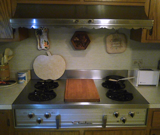 Photo showing vintage Chambers In-A-Counter cooktop with vintage range hood in a modern kitchen