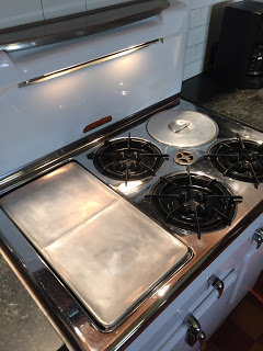 A polished griddle on a restored vintage Chambers stove model 90c
