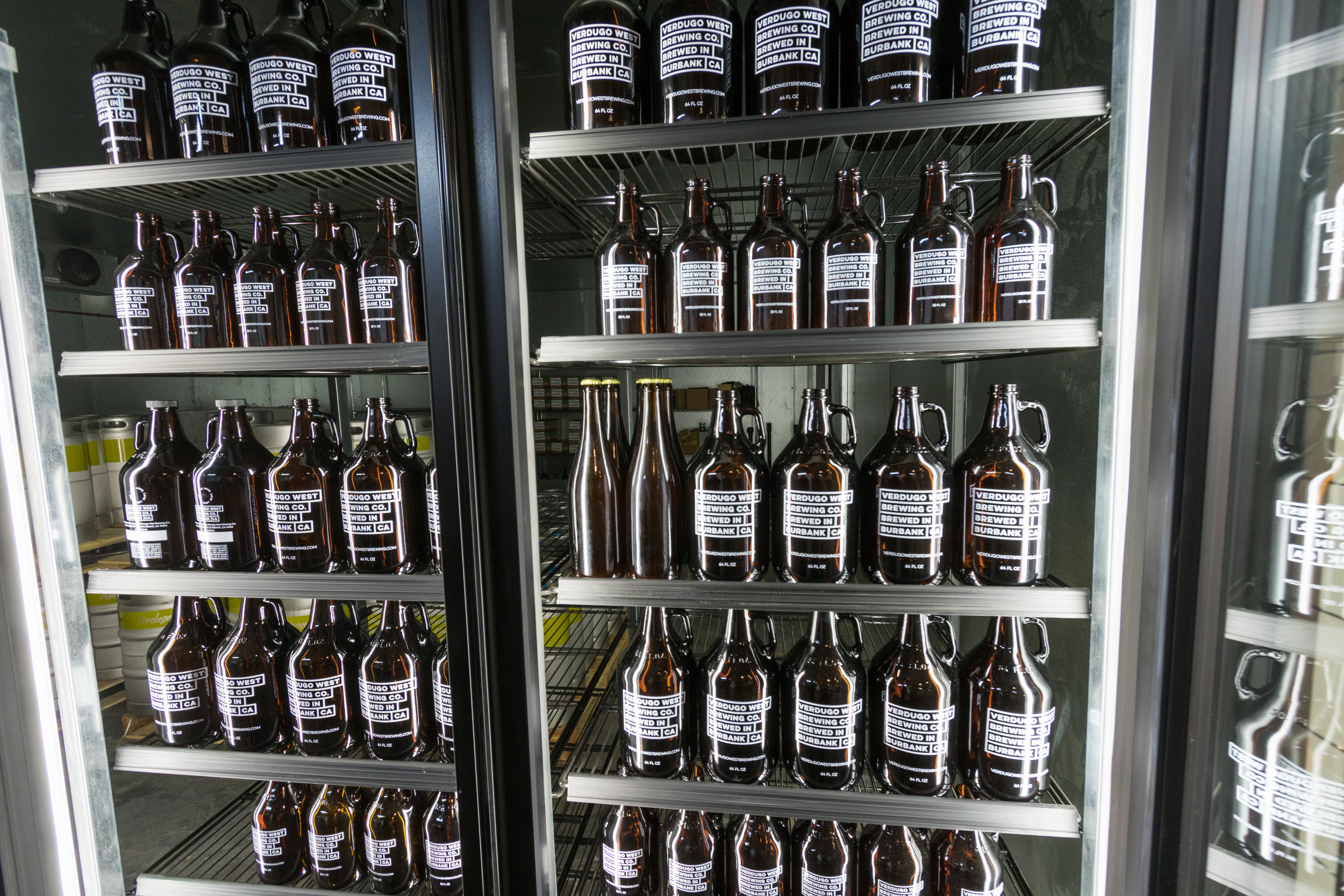 Brown Casks of Beer in a Refrigerator