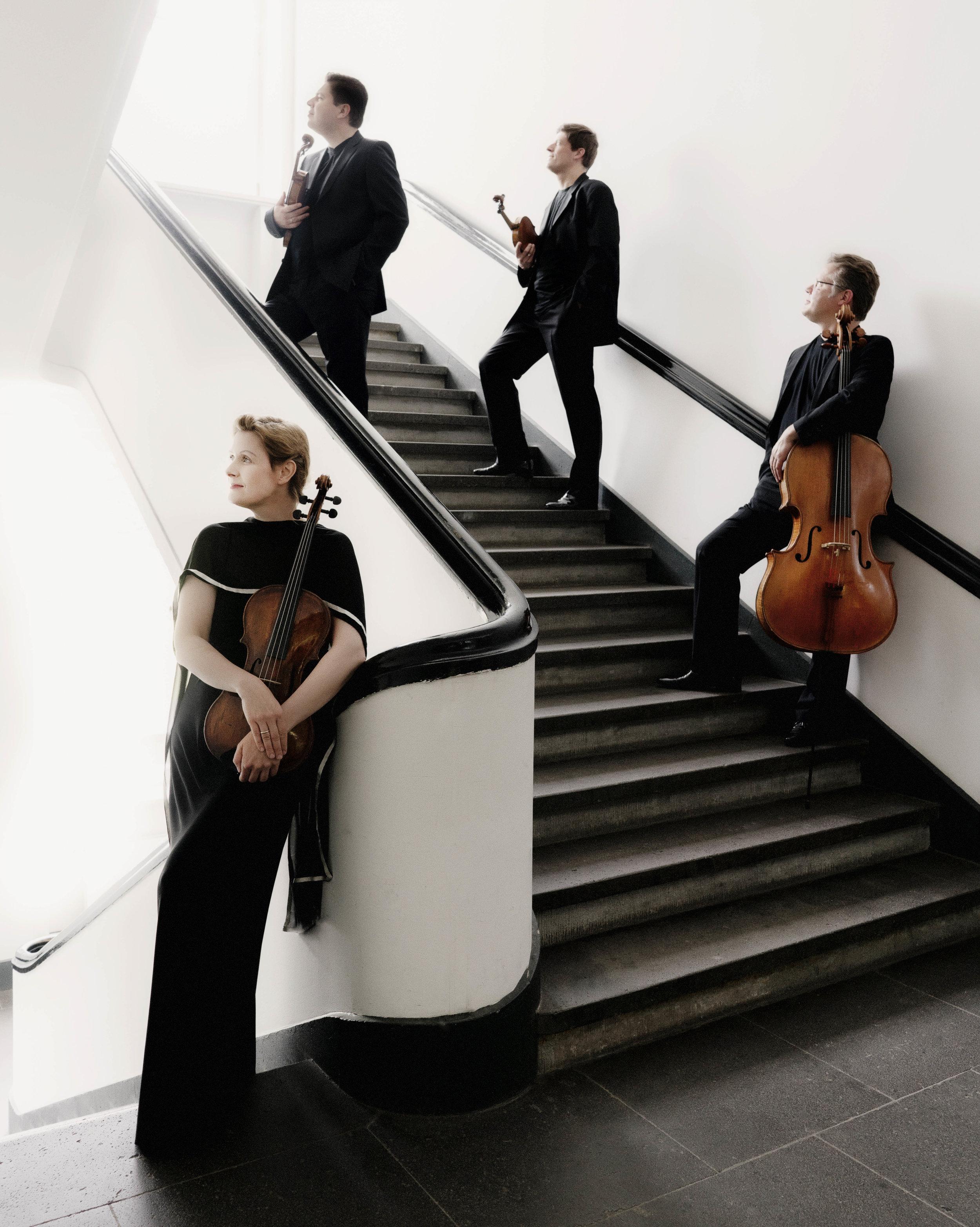 Henschel Quartett standing on stairs.jpg
