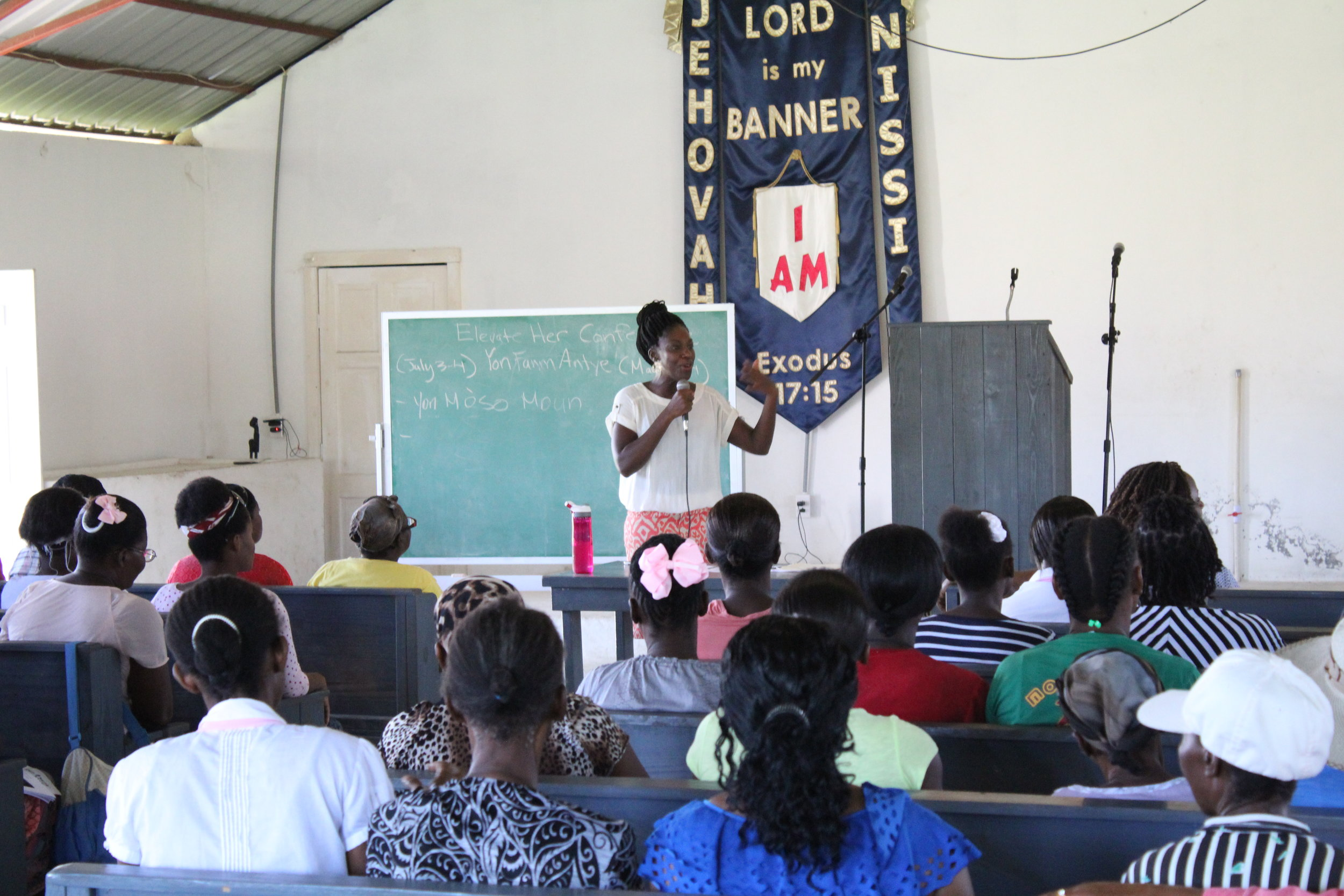 Dieula teaching at the women's conference.
