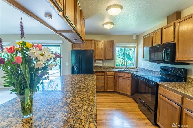 Wonderful storage, hardwood floors, and great countertops in the kitchen.