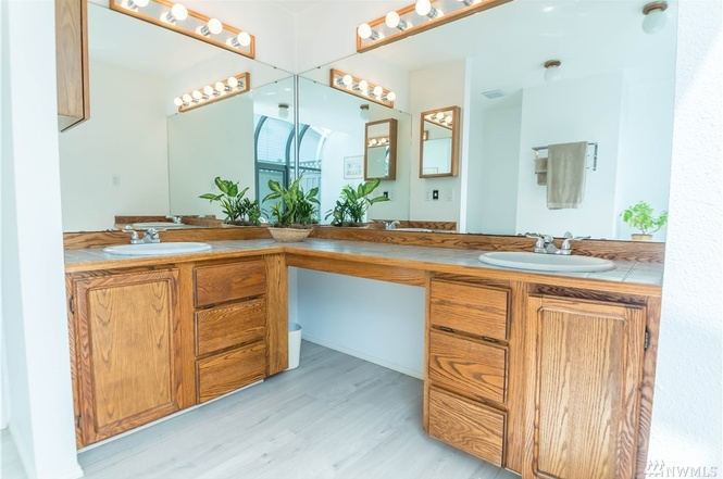 His and hers sinks, ample storage, and easy to maintain floors.